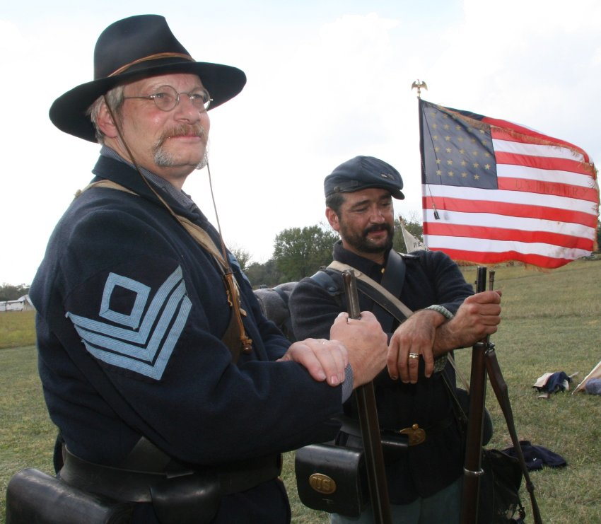 Civil war reenactments - soldiers with weapons and flag