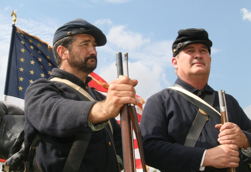 Civil war reenactment, soldiers and flag