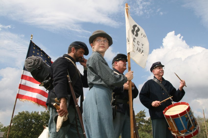 Civil war reenactment with drum and flags