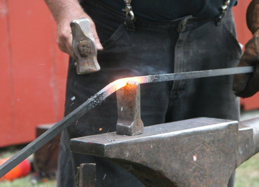 Blacksmith pounding hot iron